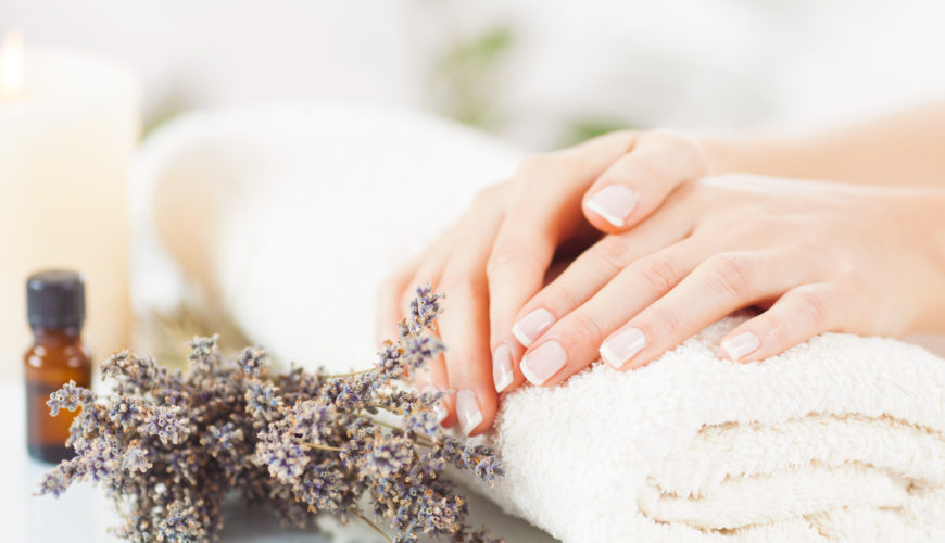 Close up oh beautiful female hands having a spa treatment with aromatherapy oil