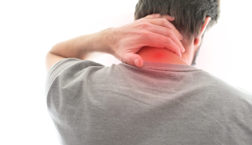 rear view of man suffering from neck pain